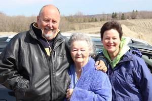 Alec Cloke with property owner, Mrs. Lee and her daughter