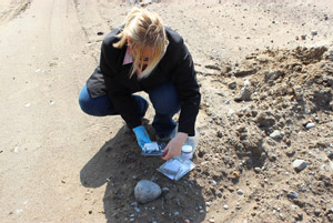 Protocol Control officer , Lori Loughlin-Pilato demonstrating random soil testing performed regularly on site
