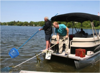 Councillor Bannon & Dr. Brian Laing fishing dead Crappie out of Musselman's Lake