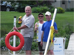 Coucillor Phil Bannon, Mike Murphy & Ian Feld install a Lake Watch life ring.