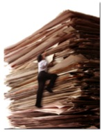 Person Climbing a Stack of Paper