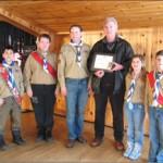 Councillor Phil Bannon receives an award from Ballantrae Scout.