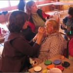 Christine Laing (President of MLRA) paints faces.