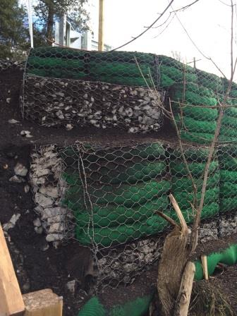 Green Gabion is an environmental friendly gabion type used for erosion control for rivers, shorelines and stream banks. They provide immediate and long-term erosion control and create hospitable conditions for plant establishment. Green Gabions help to slow water velocities near the banks and trap sediment. They are made of PVC coated wire mesh baskets with an inclined face of 45° or 60°, lined with a coconut fiber blanket on the facing and filled with a mix of stone and topsoil. The heavy coconut mat has a durability of 3 to 5 years that allows vegetation establishment. The integration of the vegetation provides a high resistance and durability of the structure. As the root system develops, it reinforces the soil providing a significant resistance to the structure.