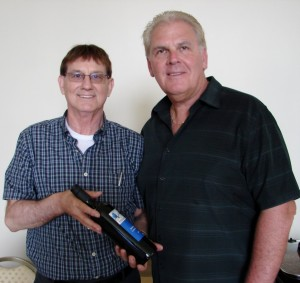 Bruce Burton, Regional Sales Representative for Pelee Island Winery with Councillor Phil Bannon