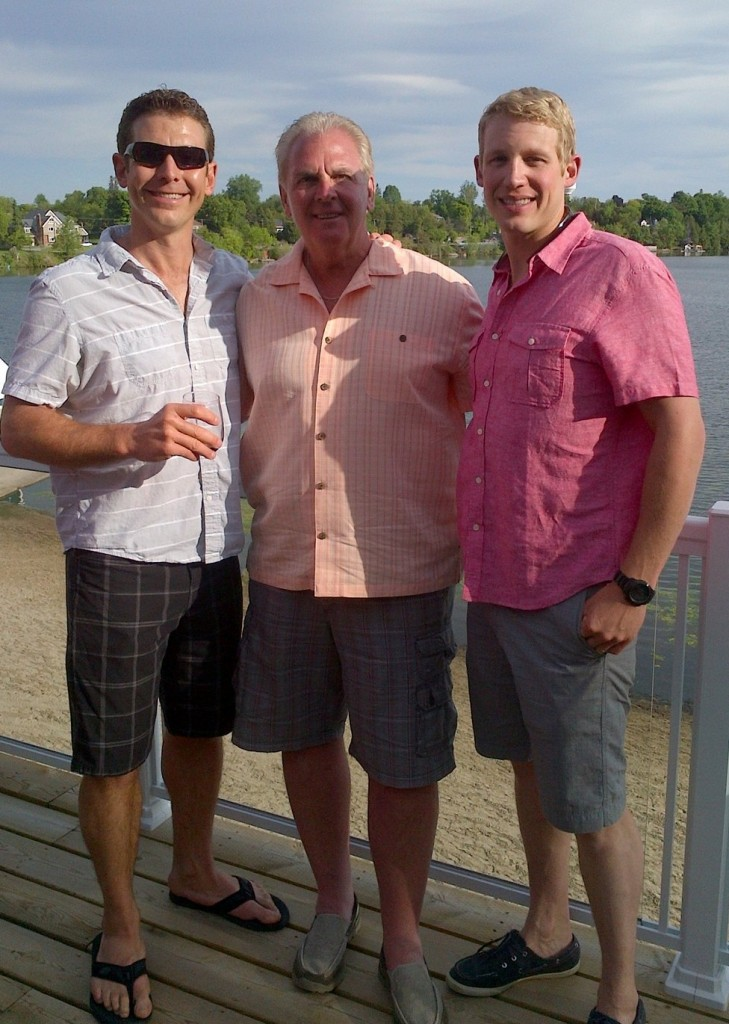 Phil Bannon congratulates Kyle Jenkin and Morgan Jenkin from Cedar Beach on their partnership with Fishbone By The Lake
