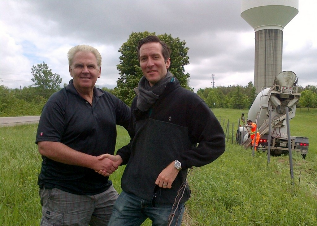 Councillor Phil Bannon, Candidate for Mayor, with Water Tower property owner at fence installation